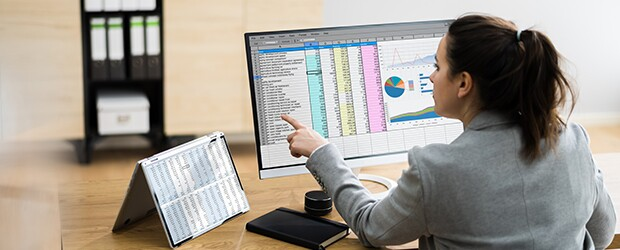 Woman reviewing finance charts