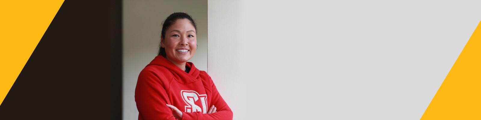 Woman wearing red Seattle University sweatshirt