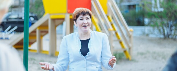 Elementary school principal speaks in front of playground