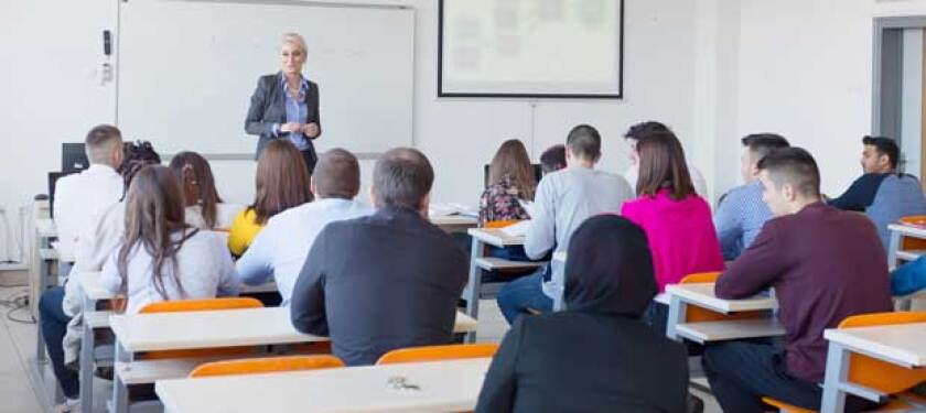 woman-teaching-a-licensing-class-to-classroom-of-adults