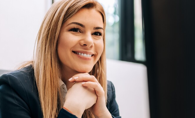 Happy woman sitting at her work desk