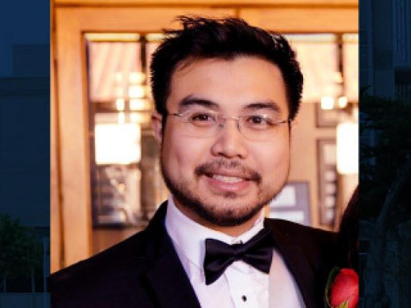 Photo of Luke Gray in a tuxedo