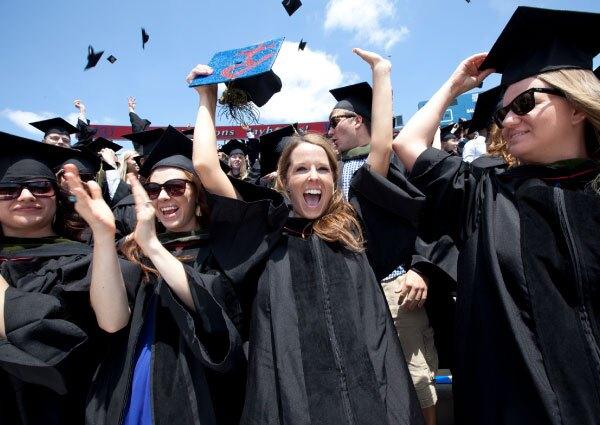 KU Graduates celebrate in cap and gowns