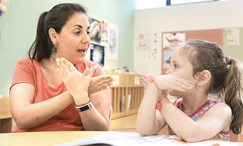 Student and sign language instructor