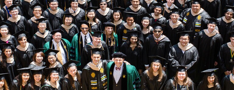 William-and-Mary-Graduates-Standing-In-Crowd-Smiling