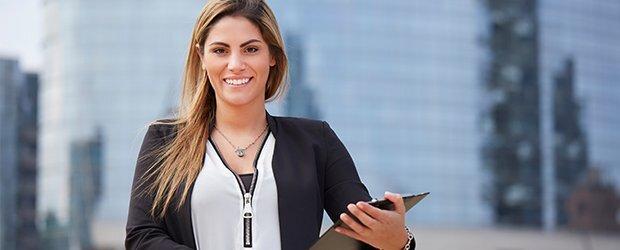 woman-in-white-shirt-zipper-holding-clipboard