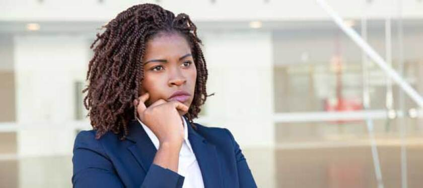 woman in business suit looking concerned