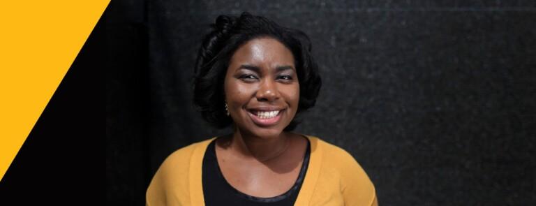 Smiling woman wears a yellow cardigan