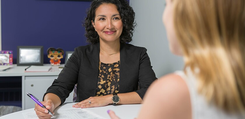 Medill advisor works with student in career session