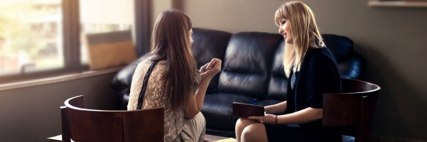 A Counselor Speaks With Client During a Session