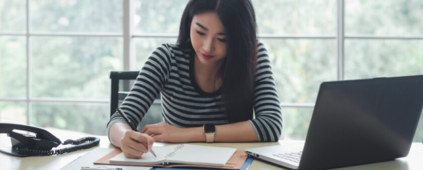 Woman studying focused at her desk