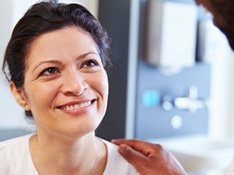 Woman-smiling-while-being-treated