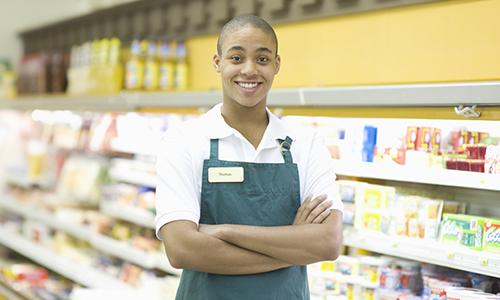 Smiling grocery store clerk