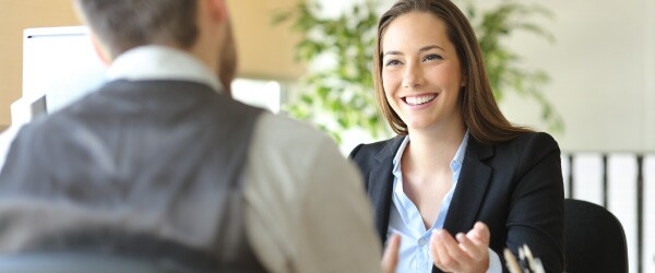 Young Professional Discusses Tuition Reimbursement With Manager