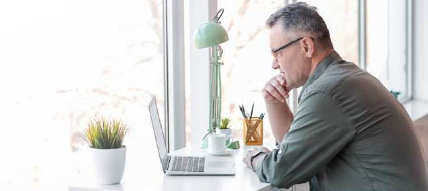 man-with-glasses-learning-on-a-computer