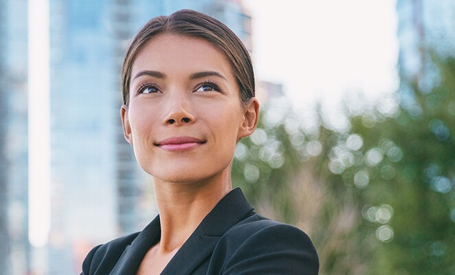 Happy-Businesswoman-Smiling-Outside