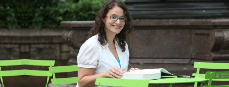 Student works at a table in NYC park