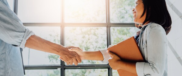 Woman Shaking Hands With Boss