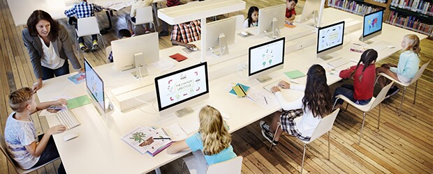 Five-kids-working-on-computer