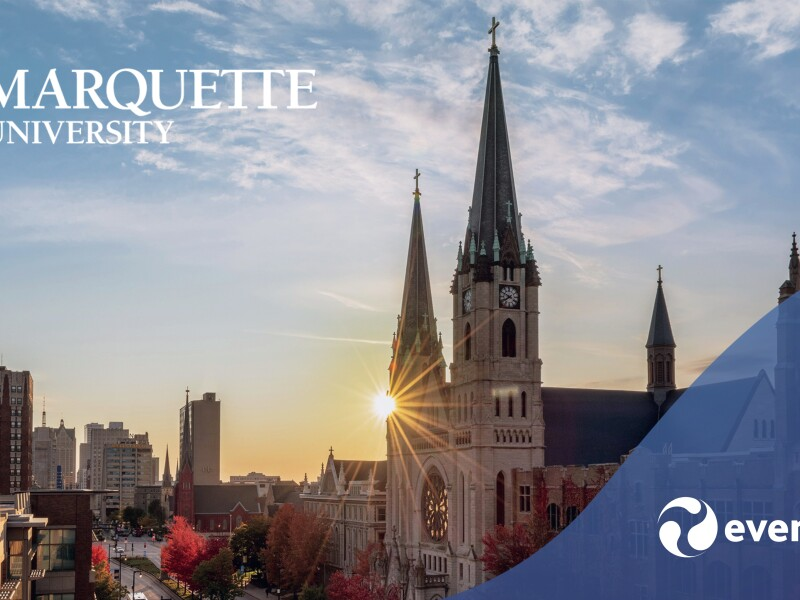 Marquette University campus with logos