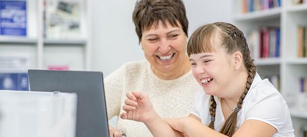teacher-helping-special-needs-student