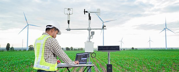 GISc technician collecting and analyzing data at a wind farm