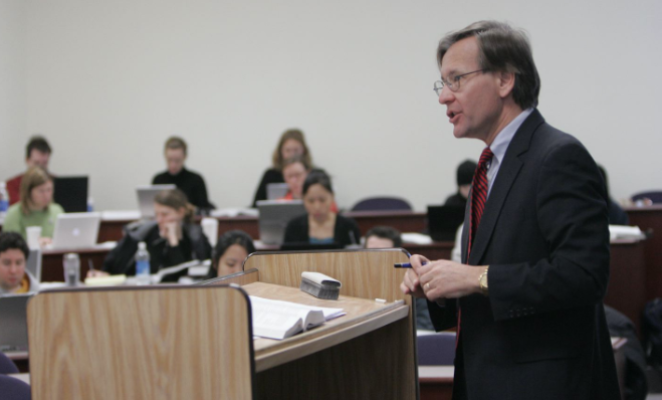 faculty member lectures to students in class