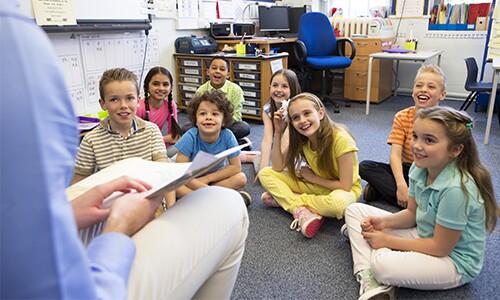 Teacher reads to diverse classroom