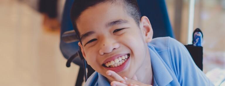 boy-in-wheelchair-smiling.jpg