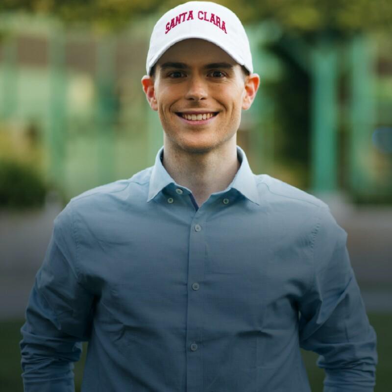 Man in blue button down wears white SCU ball cap