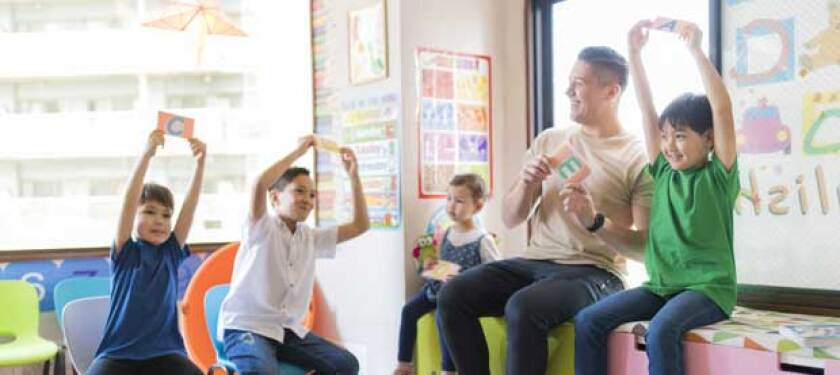 teacher-helping-young-students-learn-a-new-language