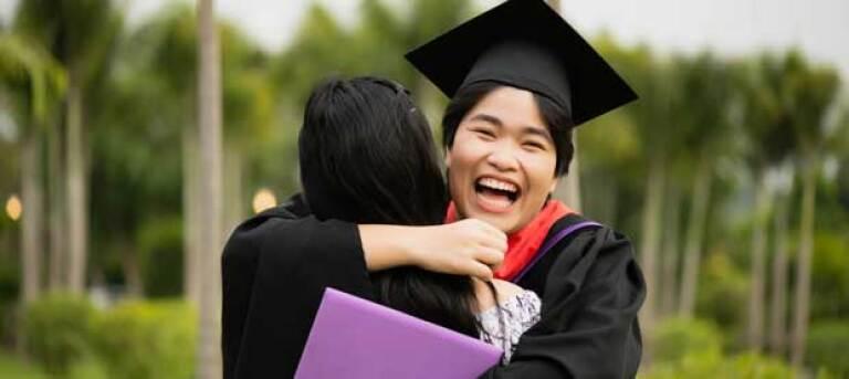 graduating-student-celebrating-with-a-hug