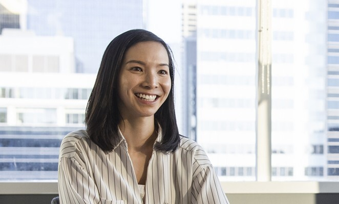 smiling-professional-in-front-of-window-in-high-rise