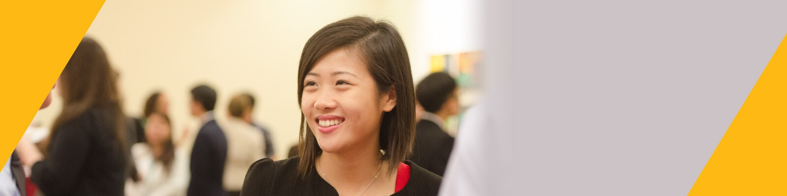 Woman smiles confidently at networking event