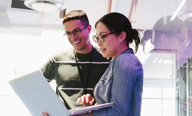coworkers-meeting-working-on-laptop